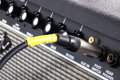 Button of guitar amplifier. With cable Royalty Free Stock Photography
