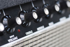 Button of guitar amplifier. Focus at treble and volume Royalty Free Stock Photography