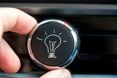 Button with a hand-drawn illuminated light bulb Stock Photos