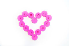 Button Heart. Pink buttons lined up in heart shape vector illustration