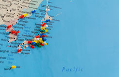 Button on Japan on the world map Stock Photography