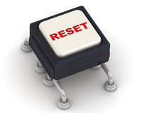 The button labeled RESET. Electronic button with a red inscription RESET on a white surface Royalty Free Stock Image