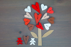 Button love tree and two bears on grey wooden background. Stock Photos