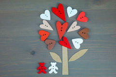 Button love tree and two bears on grey wooden background. Stock Image