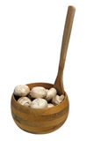 Button Mushrooms. Dirty button mushrooms in a wooden bowl, isolated against a white background Stock Photo