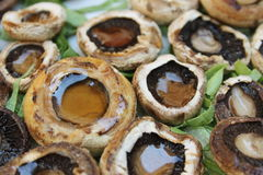 Button mushrooms. Grilled button mushrooms with salad Stock Photography