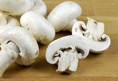 Button mushrooms. Button mushroom (Agaricus bisporus) on wooden chopping board Stock Image