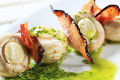 Button mushrooms and bacon on stick. With pesto sauce Stock Images