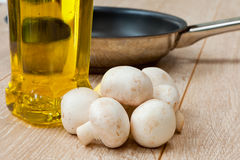 Button Mushrooms and Olive Oil Royalty Free Stock Photography