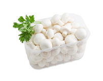 Button mushrooms in a plastic tray on a light background Royalty Free Stock Photography