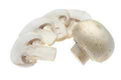Button mushrooms and slices Royalty Free Stock Images
