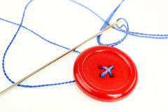 Button with needle and thread Stock Photos