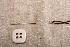 Button needle and thread Stock Photos