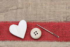 Button and needle Royalty Free Stock Images