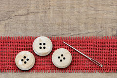 Button and needle Royalty Free Stock Photo