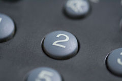 Button number two. A close up of a number two button on a remote control stock images