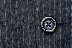 Button on a pin striped suit Stock Photos