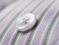 Button on pinstripe shirt macro Stock Photos