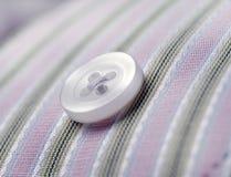Button on pinstripe shirt macro. Button on pinstripe cotton shirt selective focus Stock Photos