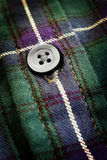 Button on Plaid Flannel Shirt Royalty Free Stock Photography