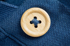 Button on a polo t-shirt fabric texture Stock Photos