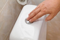 Button press cistern Stock Images