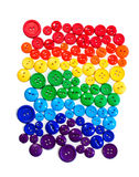 Button Rainbow. Multi colored buttons arranged in ROYGBIV format to resemble a rainbow with room for cropping stock photo