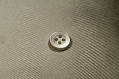 The button is reliable 1. A small, black dress button Stock Photo