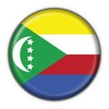 button rund form för den comoros flaggan Arkivfoton