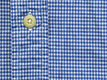 Button on shirt Stock Image
