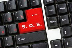 Button SOS. Computer button with sign SOS Royalty Free Stock Photography