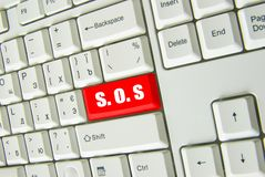 Button SOS. Computer button with sign SOS stock photos