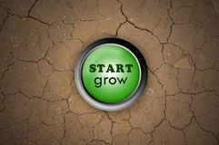 Button start grow. Green button start grow on dry ground Royalty Free Stock Photography