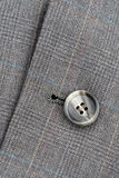 Button on suit Stock Image