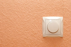 Button-switch on a wall Royalty Free Stock Photography