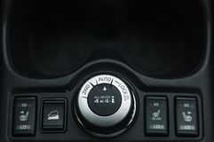 Button switches control for car with soft-focus and over light in the background. 2WD AUTO LOCK BUTTON SWITCH royalty free stock photography