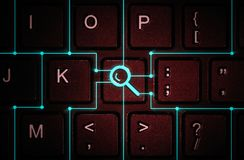 Concept of search and search services. Button with the symbol of the magnifying glass on the keyboard. Concept of search and search services Stock Image