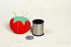 Button, thread and pincushion Royalty Free Stock Images