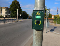 Button to activate the green light in the crosswalk Stock Photos