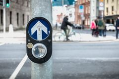 Button to activate pedestrian crossing on the road in Dublin. Button to activate pedestrian crossing on the road on a pedestrian crossing in the city center on a royalty free stock photos