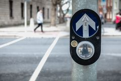 Button to activate pedestrian crossing on the road in Dublin. Button to activate pedestrian crossing on the road on a pedestrian crossing in the city center on a stock images