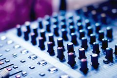Button to adjust the volume control. Button to adjust the volume control of the audio mixer stock photography