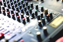 Button to adjust the volume control. Button to adjust the volume control of the audio mixer stock photo