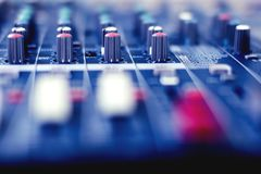 Button to adjust the volume control. Button to adjust the volume control of the audio mixer stock photos