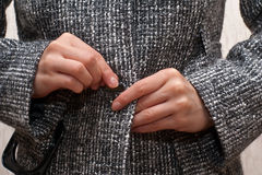 Button up her coat royalty free stock photos