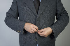 Button up. Man button up the jacket Stock Photos