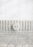 Button on wool fabric Stock Images