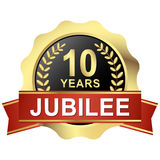 Button 10 years jubilee. Gold button with red banner for 10 years jubilee Stock Photo