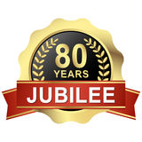 Button 80 years jubilee. Gold button with red banner for 80 years jubilee Royalty Free Stock Photo
