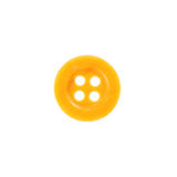 Button, yellow texture with four holes Royalty Free Stock Image